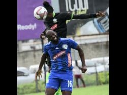 Molynes United's Andrew Peddlar wins a header over Mount Pleasant's Francois Swaby in their Red Stripe Premier League encounter at Drewsland on October 6.