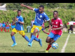 Camperdown's Shaqueil Bradford (right) is hounded by Hydel's Michael Thompson (centre) and Shaquise Batice during their ISSA/Digicel Manning Cup encounter at Alpha Boys' Home  yesterday.