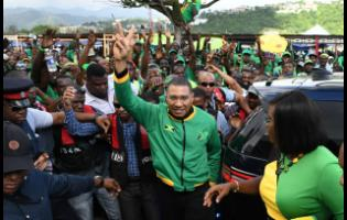 Jamaica Labour Party Leader, Prime Minister Andrew Holness, acknowledges party supporters at last year's annual conference in Kingston.