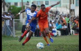 Tivoli Garden's Trayvon Reid (right) challenges Roberto Johnson of Portmore United in a foot chase during their RSPL match at the Edward Seaga Sports Complex on Sunday, November 17, 2019.