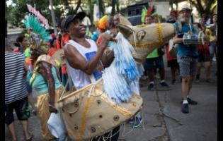 Patients from the Nise de Silveira mental health institute dance during the institute's carnival parade, in the streets of Rio de Janeiro on Thursday. Patients, their relatives and workers from the institute held their parade before the start of carnival, which begins today.