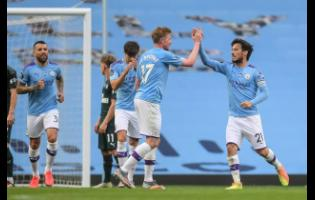 Manchester City's David Silva (right) celebrates after scoring a goal during the English Premier League match against Newcastle United at the Ethiad Stadium in Manchester, England, on Wednesday.