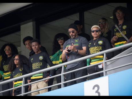 Reggae Girlz ambassador Cedella Marley (centre) stands during the playing of the Jamaica National Anthem at the Reggae Girlz versus Italy match at the 2019  FIFA Women's World Cup. The match was played at Stade Auguste-Delaune in Reims, France, on Friday, June 14.