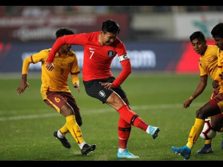 AP South Korea's Son Heung-min (centre) kicks the ball past Sri Lanka's Mohamed Aman (right), during their Asian zone Group H qualifying  match for the 2022 World Cup at Hwaseong Sports Complex Main Stadium in Hwaseong, South Korea, yesterday.
