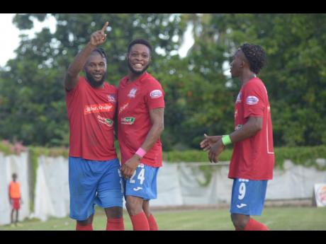 Dumbeholden's goalscorer Dean Andre Thomas (centre) celebrates with teammates Andre McFarlane (left) and Demario Phillips after finding the back of the net against UWI FC on October 27, 2019.